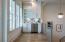 Bonus Living Area with Wet Bar featuring Designer Backsplash and JennAir Minifridge