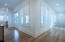 1st Floor Hallway featuring Hardwood Floors Throughout the Home