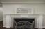 Gas log fireplace in den.