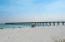 Navarre Beach is famous for having the longest fishing pier on the entire Gulf of Mexico, which borders the National Seashore extending out 1,545 feet in length and thirty feet above the water.