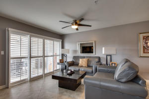 Living area, Plantation shutters on sliding doors leading to large patio