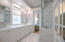 MASTER BATH FEATURES ALL MARBLE TILE AND COUNTERS, GRASSCLOTH WALL COVERINGS AND RESTORATION HARDWARE FAUCETS AND MIRRORS