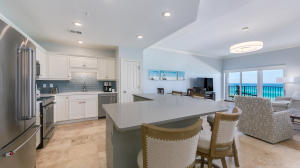 Open concept Kitchen and living area with stainless appliances, quartz countertops.
