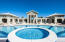 Pool at the Retreat with Lounging Areas and Spa