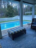 Looking at pool from screened-in porch
