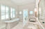 Appointed with distinguished and high-end fixtures, this bathroom is swoon-worthy to even the most particular of buyers.
