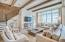 Venecian Plaster walls and reclaimed wooden beams extend across the main open-concept living area.