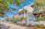 Traipse up the beautifully landscaped sidewalks of Water Street onto the Entryway of this gem of a Beach House.