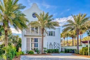 A STUNNING WHITE STUCCO 5 BR/4.5 BA HOME w/ tile roof is in the PRIVATE GATED SOUTH SIDE COMMUNITY of ELYSEE, between Alys Beach & Rosemary.