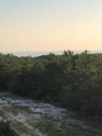 Looking at the Gulf over the tree tops of Topsail State Park. This would be your view from 3rd floor of your home.