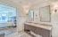 1 of 2 MASTER SUITES, both w/ soaking tubs, separate shower, & double vanities.