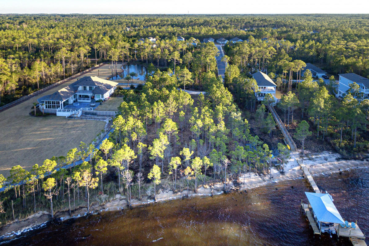 This is a rare and gorgeous 1.767 acre property that sits on the Choctawhatchee Bay in South Walton. Come build your dream home on this expansive property with all the opportunities to enjoy life on the water. It is not uncommon to see dolphin, dear, and bald eagles that nest near by all in the same day. Fishing can be enjoyed on both sides of the property. This lot includes a stocked fresh water pond that is shared with the adjacent neighbor. There is more than enough buildable space with the ability to take advantage of the full width of the lot. FDEP & Army Cor permits and mitigation have already been obtained and are current. No HOAs or build out time. Less than 10 minutes to the nearest 30A beach access and the shops & restaurants of Grand Blvd at Sandestin.