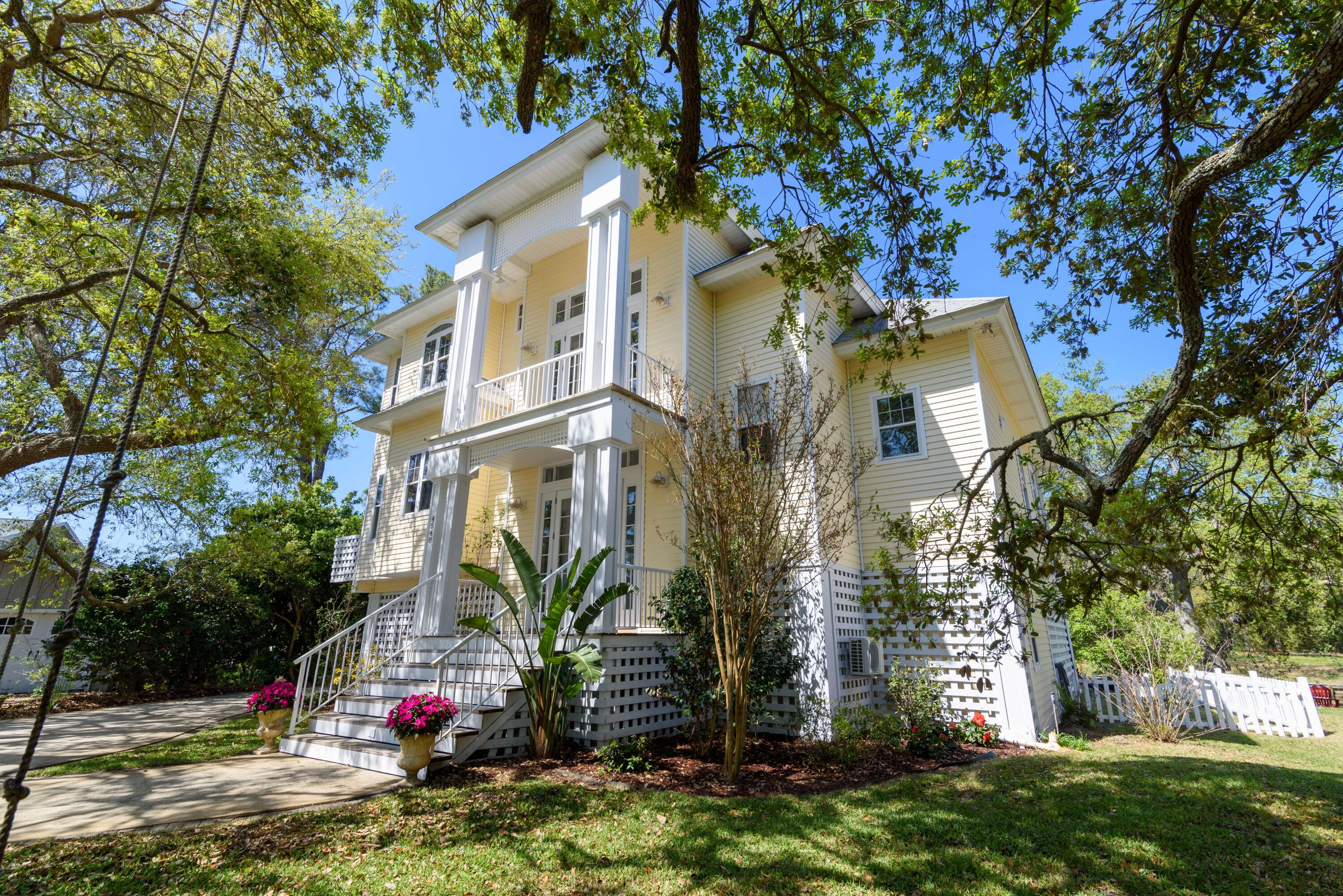 Located on a cul-de-sac just steps from the Santa Rosa Sound with 135 feet of deep water canal frontage, this home is the epitome for Florida living! You'll enjoy the 26 foot, 10,000 pound boat lift with boathouse, jet ski lift, 50 amp to dock and room for 2 additional large boats. This backyard oasis features an outdoor kitchen with built-in grill with mini fridge and microwave, large bar area perfect for entertaining with covered (33x22) and open lanai, outdoor shower, firepit and sizable back yard. The 2 car garage has a large additional workshop space and covered storage area (17x13). Also located on the bottom floor is a brand new addition. You'll find a bedroom with a kitchenette, bathroom with walk-in shower and mini split HVAC. This space would make for a good guest or in-law space  or even an Airbnb. On the main living floor, you'll find the master suite, kitchen and living space with water views from every window. The kitchen comes equipped with granite counter tops, gas cooktop, breakfast bar and stainless appliances. Just off the kitchen is the dining room and spacious living room with a fireplace and cathedral ceilings. You'll enjoy the ample natural light throughout the home as well as the custom Eastern White Pine hardwood flooring imported from New York. The master suite has French doors with a separate entrance to the covered balcony providing water views and the bathroom has a walk-in shower with 2 shower heads, heat lights, double granite vanity, urinal and a large walk-in closet. The 3rd floor has 2 additional bedrooms and full bathroom with a shower-tub combo. Other notables are IMPACT GLASS, large balcony with dining and living area on second floor just off the main living area, office nook just off the kitchen, powder room, recessed lighting, surround sound, crown molding, beautiful oak trees, and second bedroom upstairs has a private balcony overlooking the water. Check out or full video tour on the MLS and YouTube.