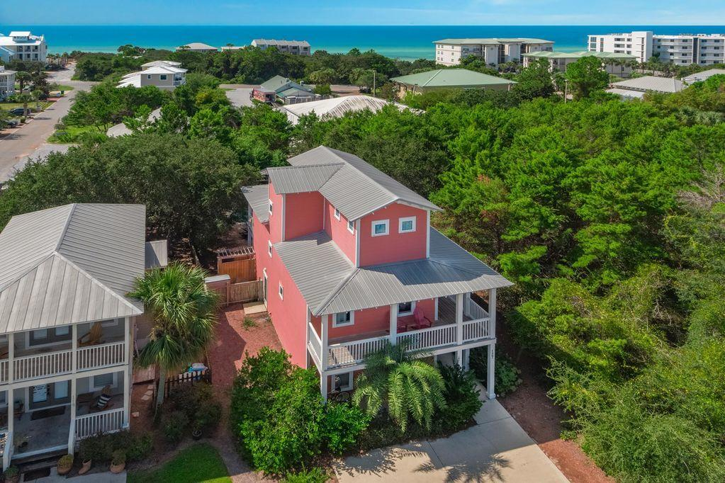 Welcome to Elizabeach! You won't want to miss this charming Old Florida home located in the heart of Seagrove beach. This stunning three story abode offers gulf views, a heated private pool and can accommodate up to 14 beach goers! This really is a private beach oasis, featuring a lovely lagoon shaped pool, private fenced in backyard, paver stone patio, with adirondack seating, fire pit, smoker grill and plenty of seating to relax and soak in the Seagrove beauty.  This accommodating five-bedroom home includes two Master Suites with private luxury baths, and one of them is on the third floor with an open Observation Deck. This design plan with bedrooms on all three levels works well for two sets of families. The tropically landscaped home has a gracious look and feel thanks to a wrap-around