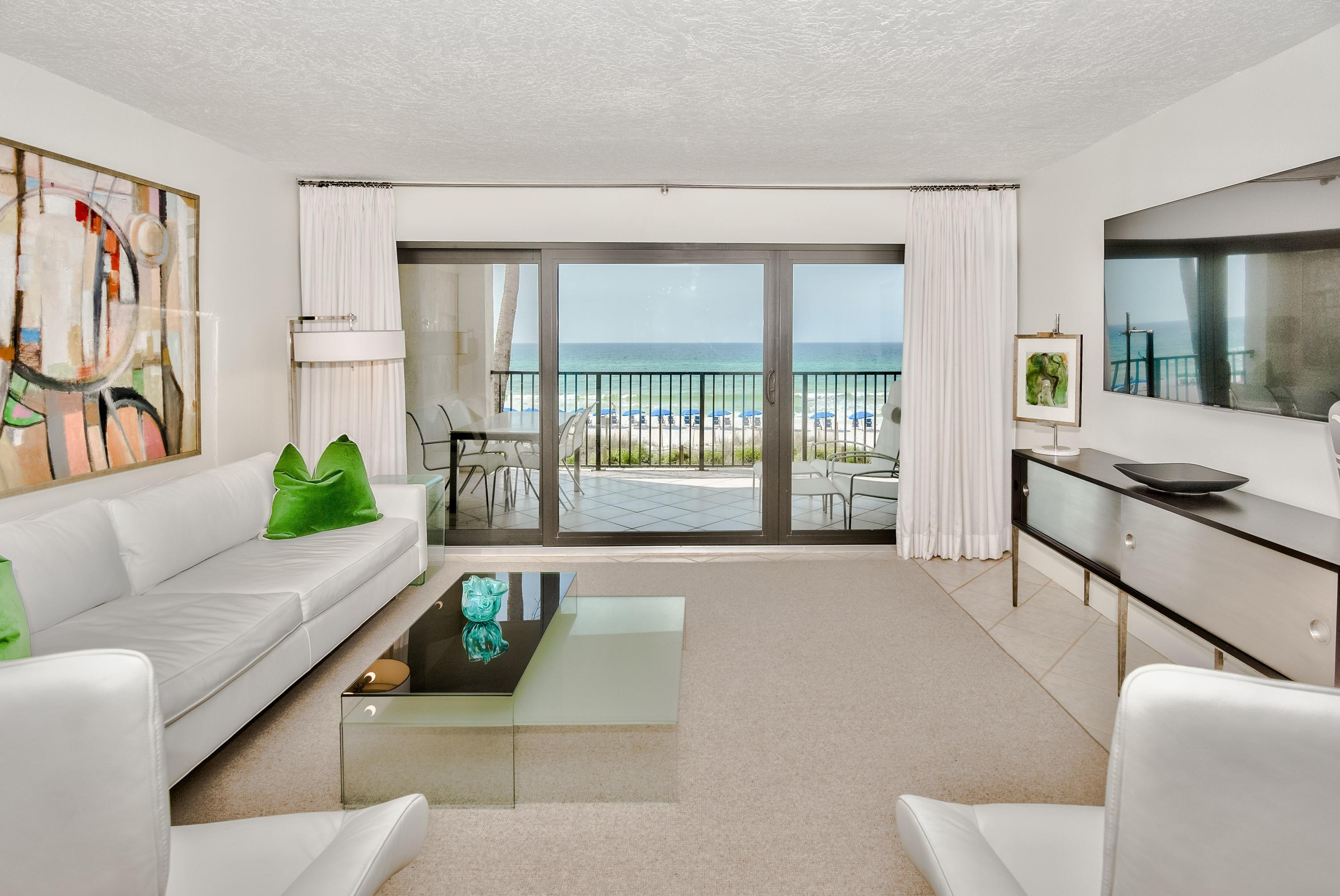 This immaculate unit has modern touches but still welcomes you to the beach from the moment you walk in the door.  High end finishes throughout and a master suite with a remarkable view.  Huntington by the Sea is peaceful and highly sought after complex for a reason.  It's gated privacy and low density vibe are just a couple reasons these units don't sit around for sale long.
