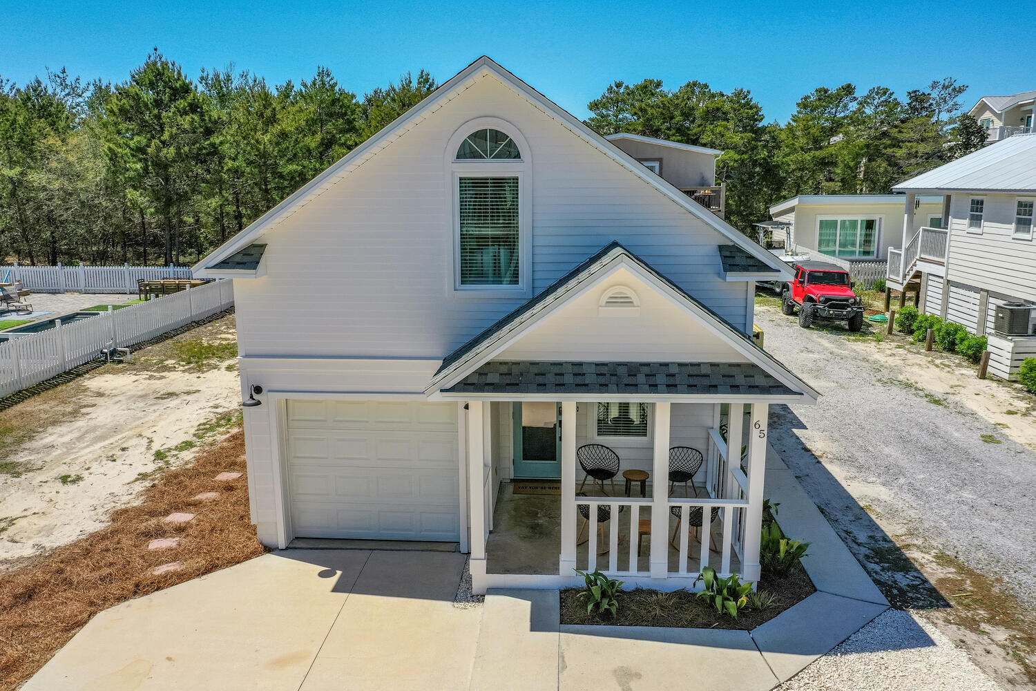 TOTALLY RENOVATED FULLY FURNISHED BEACH COTTAGE IN SEAGROVE ON THE SOUTH SIDE OF 30A! BEACH ACCESS IS WALKABLE AS IT IS ONLY ABOUT 1/4 MILE! NO HOA!  Exterior...New paint, new doors, new landscaping, new fence. Interior...new LVP flooring throughout, new quartz countertops, new sinks and faucets, new crown molding, new custom glass and tile shower in both masters, new lighting,  and ceiling fans throughout, new interior doors, duct work to make entire house run on central A/C. All new furniture and mattresses.**Buyer to verify all measurement