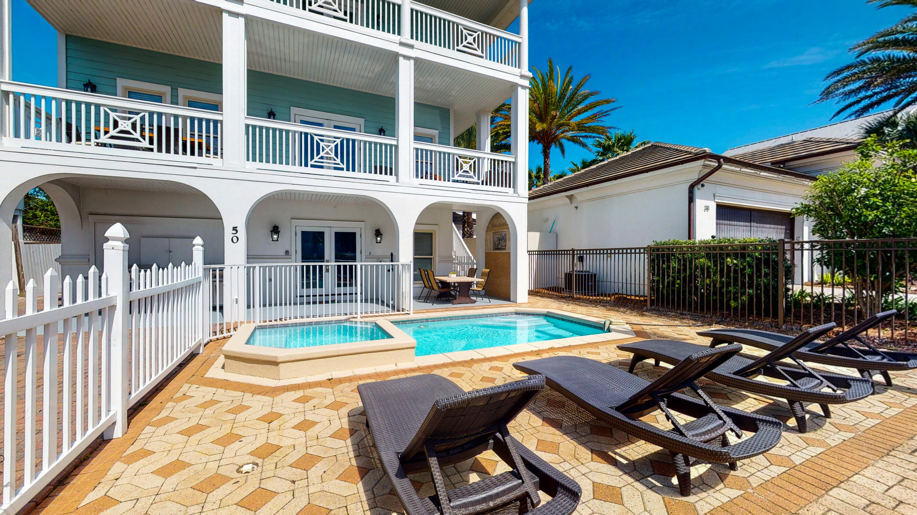 """Welcome to ''Coconut Castle''.  This Frangista Beach home is supremely positioned less than a block from the deeded beach access for the community. There is already over $160,000 of rental income on the books for 2021.  The current management company, Beach Reunion, is making available a rental income guarantee of $180,000 for the first year of ownership if you keep the home on their rental program.  Opportunities like this do not come along very often!This large home is being sold fully furnished and offers a total of 5 king bedrooms each with their own private baths, 2 spacious bunk rooms with a shared bath, another king bedroom, and a queen loft area. The 1st floor boasts both a game room and media room complete with pool table, wet bar, and full-sized refrigerator. Also located on the 1st floor is 1 king bedroom with private bath and the 2 bunk rooms with shared bath, all with access to the private splash pool and overflow spa.  The 2nd floor contains the sprawling living room, dining area and kitchen with large granite island/breakfast bar and all stainless-steel appliances. Also 2 more king bedrooms, 1 with private bath.  The 3rd floor offers a private balcony and sleeping arrangements for 8. You will find the master king suite with built-in bunk beds, wet bar with mini fridge and spacious private bath with a jacuzzi tub. Also, two more king suites with their own private baths.  On the 4th floor you will find the look-out tower with gulf views and the queen loft area that provides 360-degree views.  Call to arrange your private showing of """"Coconut Castle"""" TODAY!"""