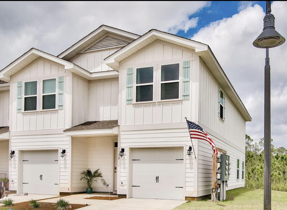 Location is key here for this beautiful end unit, townhome in Santa Rosa Beach! Unit F features 3 bedrooms and 2.5 baths along with a 1 car garage!  It is practically like new, with tons of charm and an open concept and luxury flooring throughout!  The kitchen features granite countertops and bar space, beautiful white cabinets, stainless steel appliances and pretty white subway tile backsplash!  Upstairs, you'll find all 3 bedrooms, 2 full bathrooms and your laundry room conveniently located in the hallway!  Out back, grill in peace and enjoy some privacy along with the pond/forest views.  The unit is also conveniently located near the community culdesac and mailboxes.