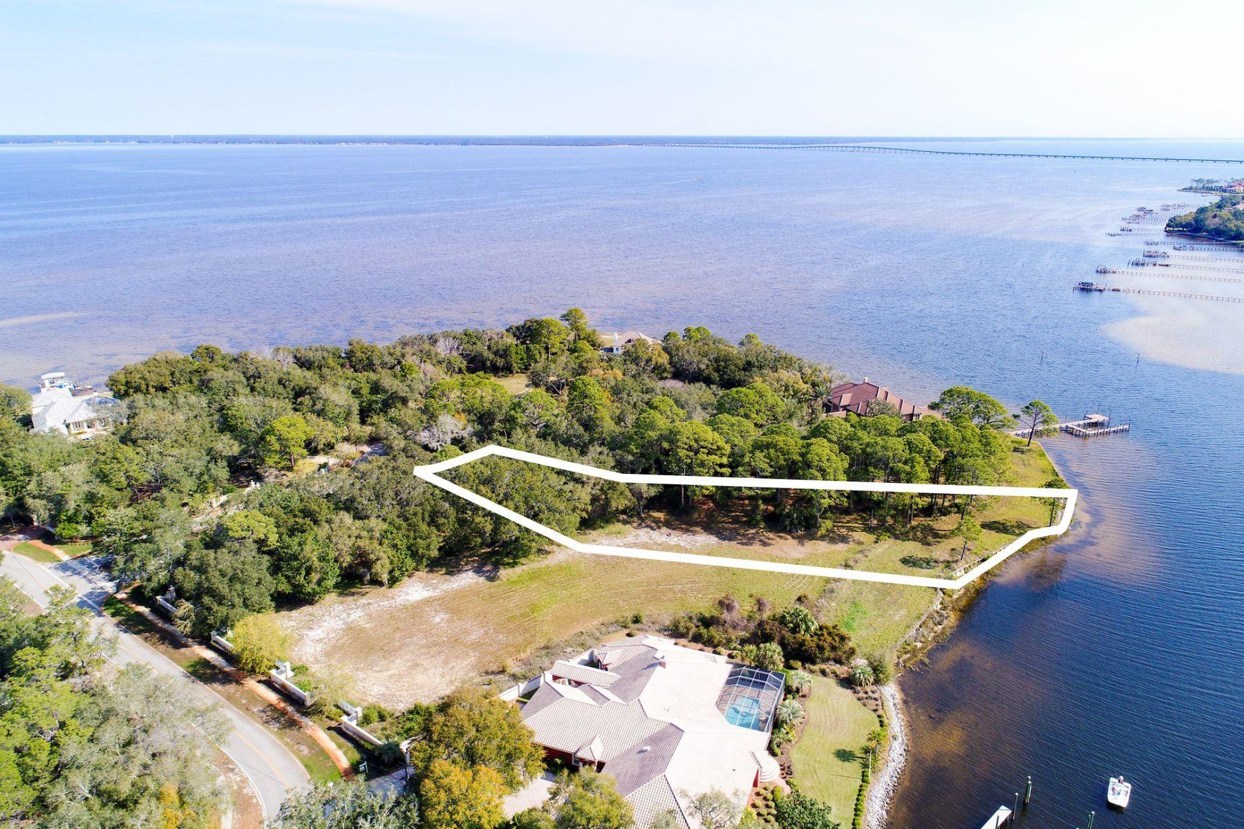 The Estates at Indian Pointe is a gated enclave of Bay and Bayou front home sites in Destin, Florida. This .87 acre Bayou front lot features deep water access, essential for the avid boater. Tucked away at the very east end of Indian Trail, occupying what is perhaps the most remote waterfront location in Destin, this especially private piece of property is only an 11 minute drive from beach access with parking, as well as shopping, dining, seasonal entertainment, and chartered fishing excursions at Harborwalk Village on the Destin Harbor. The Estates at Indian Pointe is the pinnacle of luxury waterfront living for those who refuse to compromise the beach lifestyle in order to pursue their passion for boating.