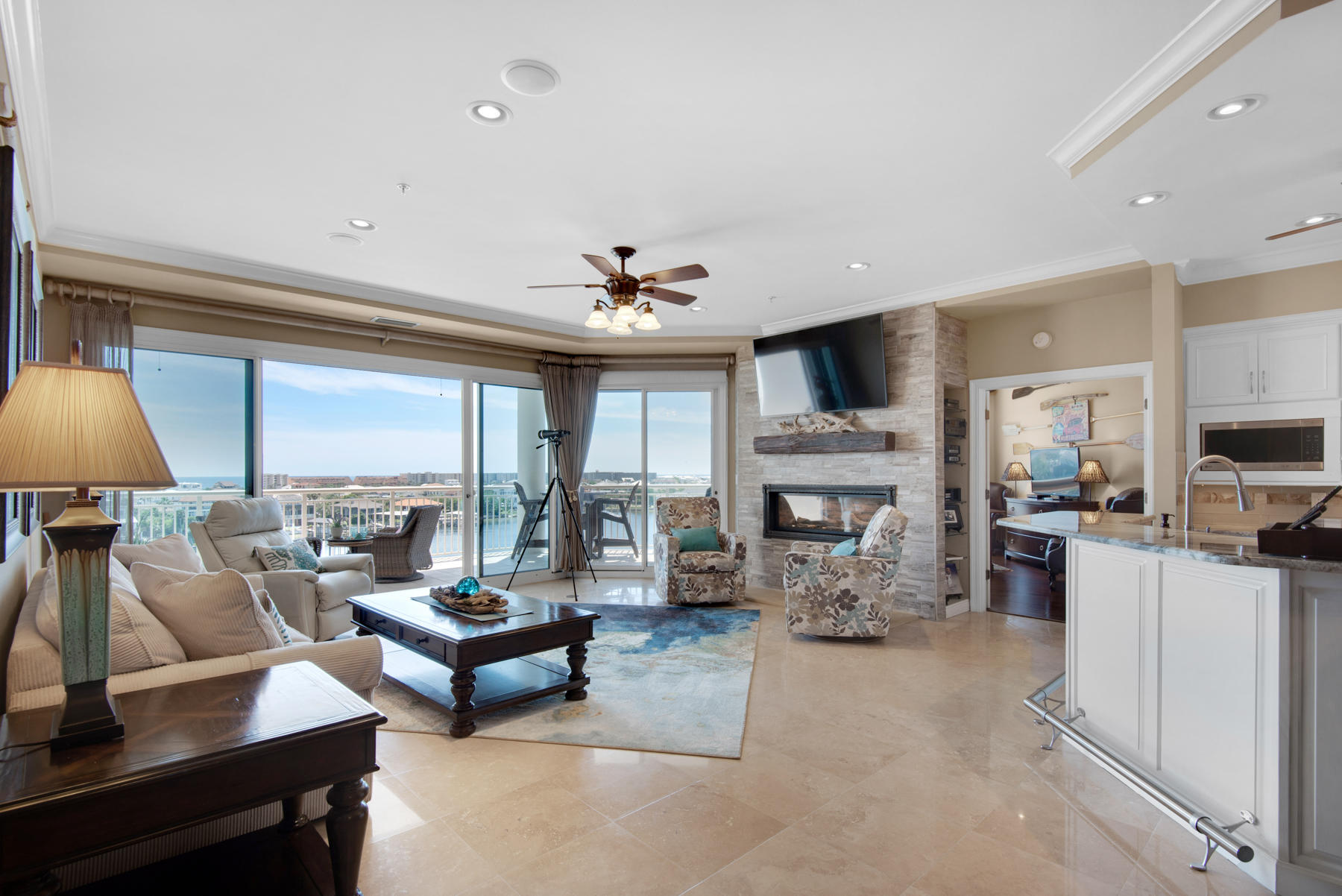 Enjoy Stunning Gulf and Harbor Views from this amazing 5th floor Harbor Front Condo. Look to the South and you will see the Harbor, Holiday Isle, and the Gulf of Mexico . To the West, enjoy the astonishing sunsets along with watching the excitement of the activities of the Destin Harbor. You will experience luxury living at its finest in this 3 bedroom/3 Bath condo at Grand Harbor. This spectacular condo is furnished and move in ready. Owner has paid special attention to the fine finishes and decorative features  throughout the unit.  Custom window treatments, remote controlled shades in master bedrooms and guest bedroom (currently used as an office), both with spectacular views.  Grand Harbor amenities include  pool, workout facility, amenity room for your extra guests. Grand Harbor is in the heart of Destin close to shopping, dining, championship golfing, boating, churches, and of course the  emerald green waters and white sands of the Gulf. All dimensions to be verified by Buyer.