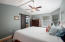 Master bedroom with barn door leading to en-suite bathroom