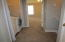 Laundry room at top of stairs. Master Bedroom entrance.