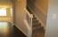 Steps up to 3 bedrooms. Newer Dark wood vinyl installed.