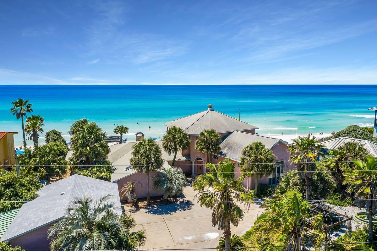 Prime building site situated on a double lot directly on the beach perched at an impressive elevation presiding over unparalleled gulf vistas located on the coveted Blue Mountain Beach Road along Scenic Highway 30A. This highly sought after location is one of the most opportunistic on 30A. This premium site has a seawall currently intact and a 4700 square foot beach house complete with 5 bedrooms, two living rooms, a great sitting room and a garage that could provide temporary use while designing a permanent residence. Blue Mountain Beach Road is adjacent to Big Redfish Lake and within excellent proximity to central 30A including Seaside, Watercolor and Grayton Beach.