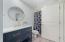 New flooring, vanity, sink and fixtures.