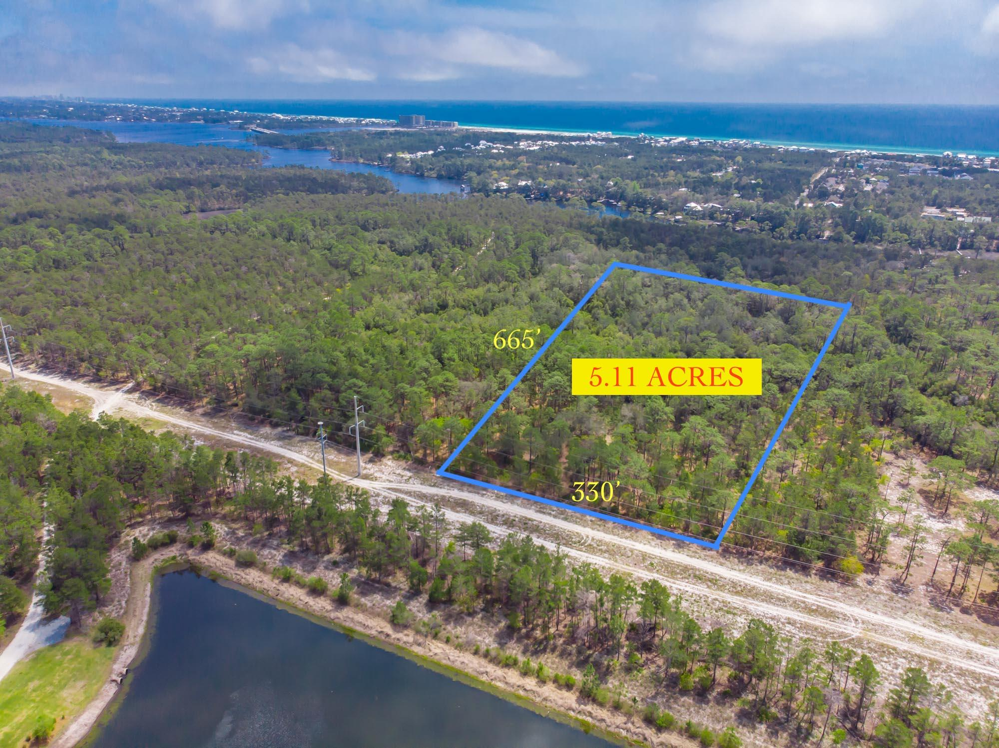 Rare opportunity to purchase over 5 acres of vacant land in Inlet beach. The property is adjacent to Water Sound Origins development. Property is high and dry - Zoned Conservation Residential for 2 homes per acre(10 homes). In the X flood zone. Steps from Lake Powell and short drive to the beach.