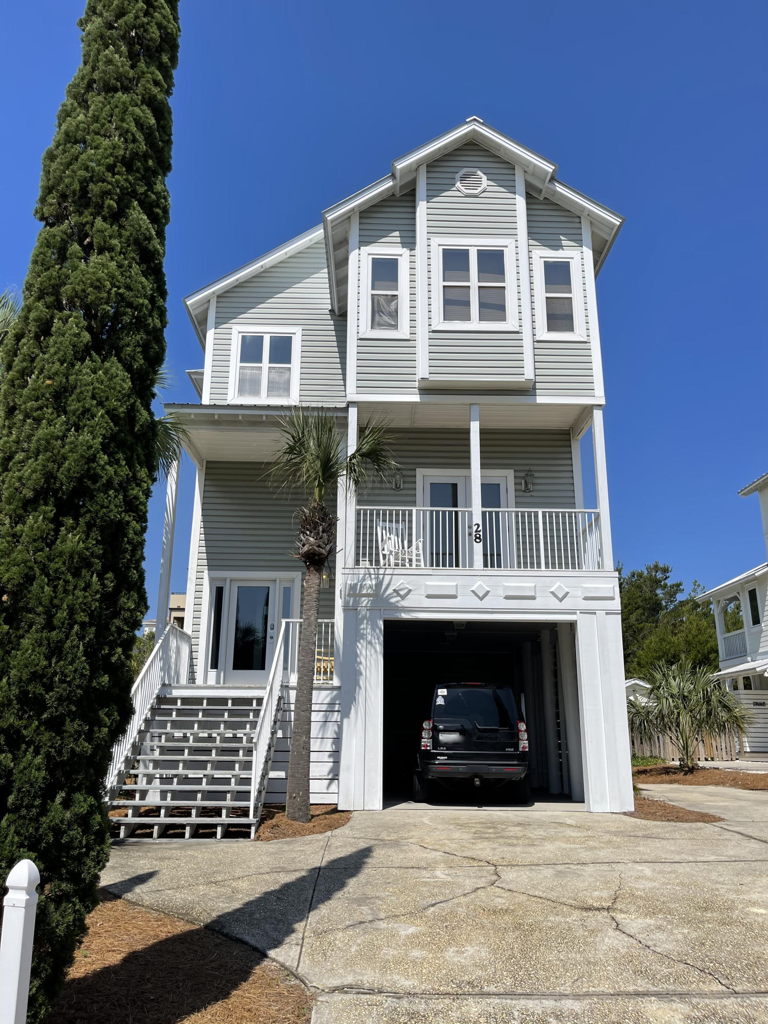South of 30A, 5 bedroom, 5 bath with private pool.  Walking distance to public beach access and rental ready. Home is sold fully furnished with exception to kitchen bench and chairs and items in the Owner's Closet.   First floor has tiled floors, 2 sets of bunk beds, full bath with walk-in shower and kitchenette. Second floor has 3 bedrooms and 3 baths with vinyl plank flooring throughout 2nd and 3rd floors.  Second floor has a  laundry room with tiled floors, 3 bedrooms and 2 full baths.  One of the bedrooms has a deck that over looks the pool.  As you go to the 3rd floor, you are greeted with a living room, dining area and kitchen.  You have a gulf view from the 3rd floor and master suite.  Sit on the covered deck overlooking the pool. Kitchen has a center island and barstool seating, stainless steel appliances and quartz countertop. Master suite has a deck that faces east to see enjoy morning sunrise.  Large backyard with pool, grilling for large gatherings and soaking up the sunshine.  A gas rinnai keeps you from running out of hot water,