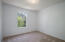 Guest bedroom. All new carpets paint. Can be used as an office space. It look out to beautiful green space..
