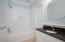 En suite bath with tub/shower and granite sink