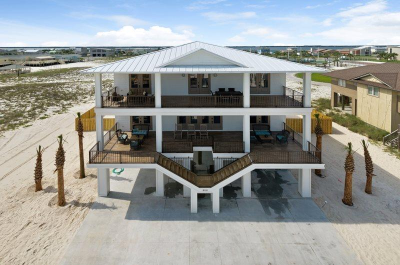 PRICE ADJUSTED! Next Showing date, Sunday, 6/27. The time has come to own one of Pensacola Beach's most LUXURIOUS and PROFITABLE rental homes! This ''BEACH VACATIONERS DREAM'' is a rental machine! This beautifully furnished home is configured with 7 bedrooms, 6.5 bathrooms and can sleep up to 27 guests. Accommodated with an open floor plan and elevator, the spacious great room delivers optimal seating to entertain single families or large groups. Enjoy the two beautifully decorated king master suites with connecting bathrooms on the main level of the home. Lavish in your gourmet kitchen with an oversized island, stainless Viking appliances, and wine fridge!  The upstairs provides 2 master suites with connecting bathrooms, 3 large additional bedrooms, and an expansive living area equipped with plenty of seating, flat screen TV, wet bar, full-sized fridge, ice maker, and microwave. The gorgeous views from upstairs can be enjoyed from the vast amount of balcony space facing the Gulf of Mexico and overlooking the large PRIVATE POOL!  The exterior of this beach home is the TRUE definition of a tropical oasis! The expansive coastal outdoor entertainment area features a private pool, lounge chairs and picnic area all protected by a wraparound privacy fence.   If you want to own a luxurious home, with record breaking rental success, then this is the home for you! Let's get YOU living the DREAM!