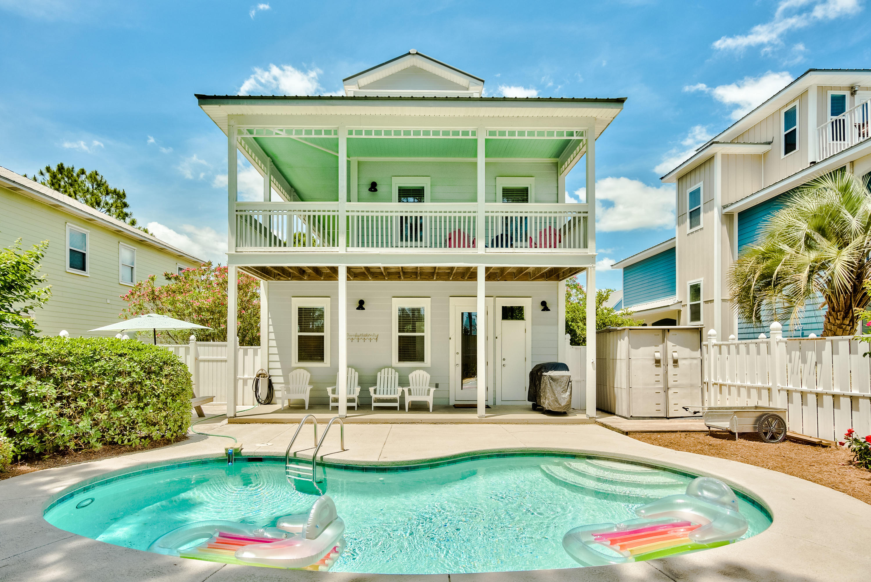 Located on 30A in the heart of Seagrove Beach, this 4 bedroom beach getaway boasts gulf views from two floors and big rental numbers, with easy access to the gorgeous Gulf of Mexico just over 200 yards away. The third floor is multipurposed with a bunkroom and separate living zone equipped with a wetbar. Experience multiple views of the gulf waters through the beautiful Florida treetops from both inside and out on the tower balcony. The home's wraparound deck and backyard's private heated pool maximize interior/exterior flow. With over 1000 sqft of outdoor deck and balcony, even with a full house, there is private space for all to embrace. Poolside includes dining, grilling and lounge areas. Home is furnished, decorated and fully stocked. Sleeping 12+ with over 80K in rentals projected. Comes with many recent improvements, including a new pool heater and pump, refrigerator, stove and washer and dryer. Upstairs hurricane rated slider recently added along with many updated furnishings, and more.  All measurements and information are deemed reliable but must be verified by the Buyer.