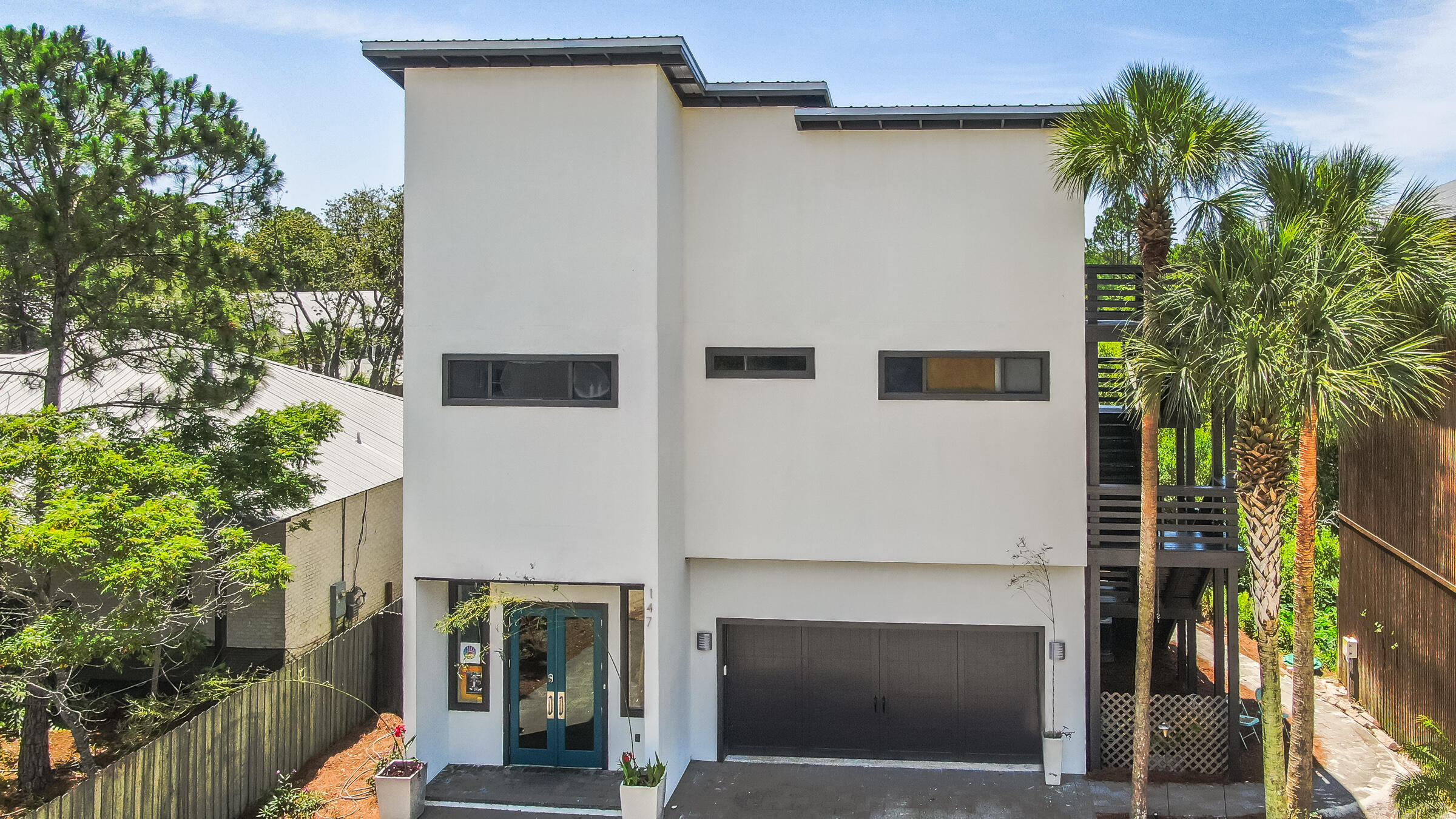 Incredible opportunity to own a Village Mix Use zoned home in the heart of Grayton beach with No HOA. Walk every morning to Black Bear, shuttle to Seaside,  or Red Bar 5 min/1 mile away. This home stands apart from others with ability to use each floor as a LT rental, or have a beach home with ST rentals, make the first floor a small business and live above or allowing a family to use each floor uniquely for their own home.  The 3rd floor is only accessible via the stairwell on outside of house, allowing a separate office area but it is not included in square footage, it will take minor adjustments to connect for bathroom, but it is finished with H&A, floor, drywall and lighting.  The backyard is spacious, room for pool. Cosmetic allowance of $10k given due to delay of contractors.