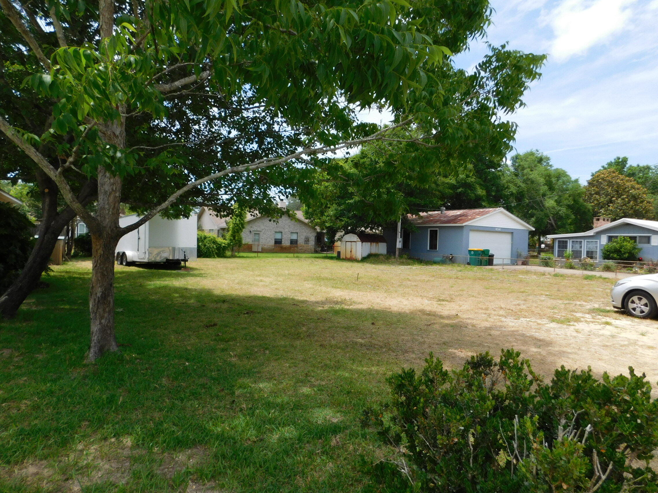 Flat lot ready to build your custom home on.  Tap fees have been paid and property already has Water, sewer and electric on the property. This lot was split off of the home to the left of it.  Please see new attached survey.