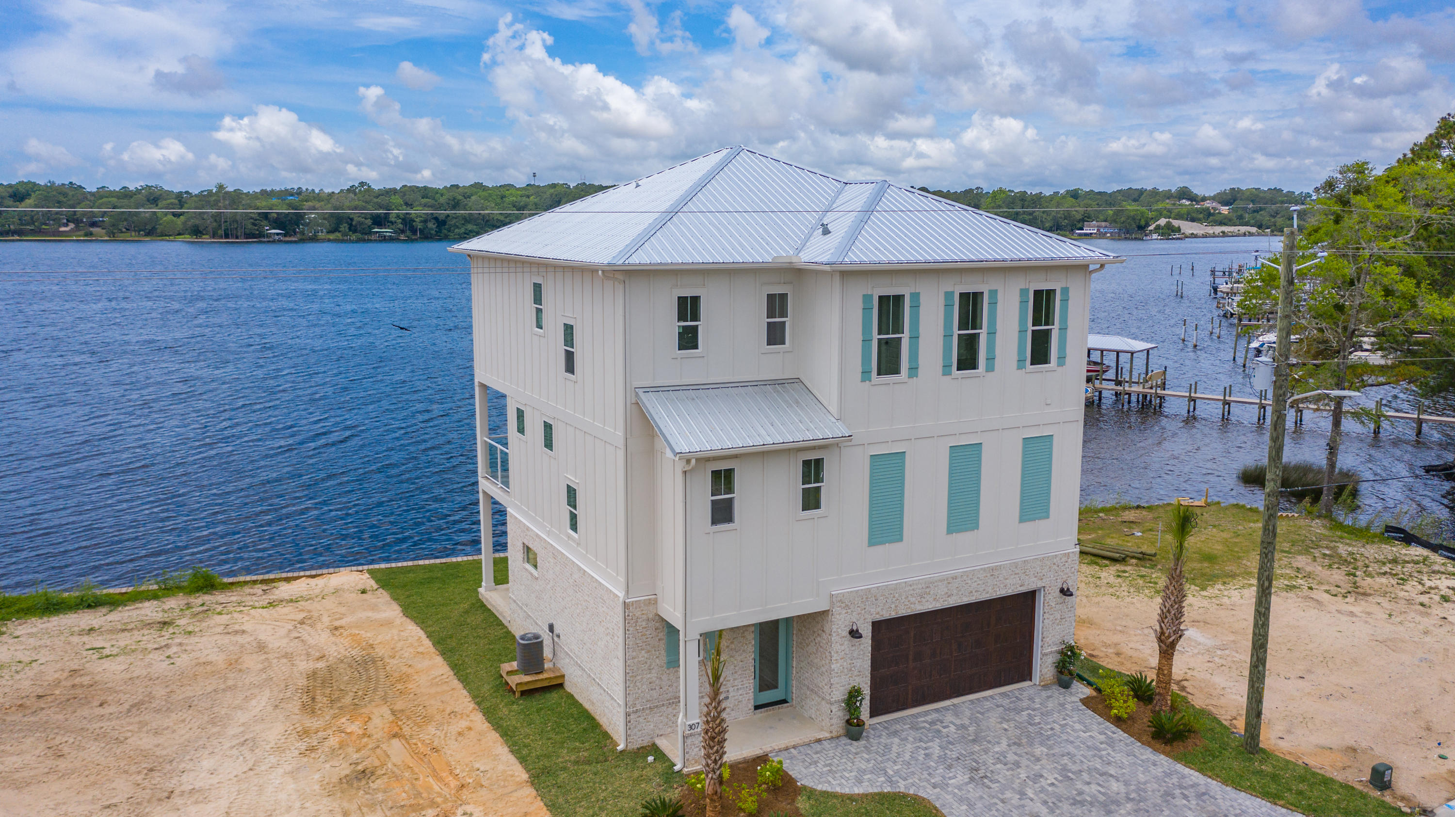 Welcome home to 307 Bayshore Drive. This brand new home is 2021 Parade of Homes Winner, located on t