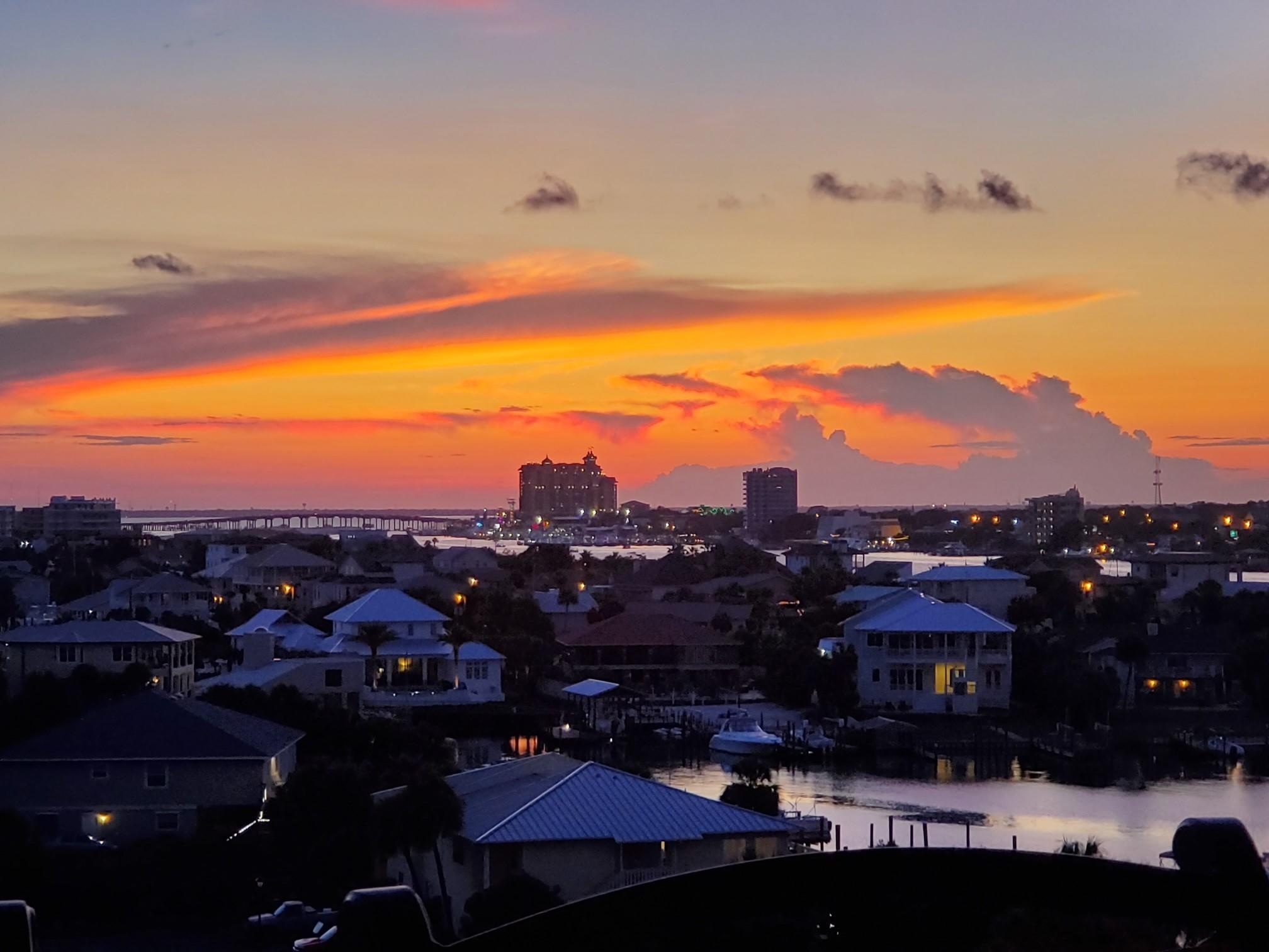 Stunning views of the Destin Harbor and the Gulf of Mexico in this 5th Floor ,3 bedroom 3 full bath condo! Imagine seeing sunsets 365 days a year on your oversized back balcony!!!! This unit has a spacious, open floor plan with Harbor and Gulf views from nearly every room. Enjoy sunrises on the 2nd balcony that is attached to one of the two master bedrooms and fireworks all summer long off the back balcony. All three bedrooms have an attached bath, one of which opens to the hallway as well.  Harbor Landing has two pools, one for owner's only and there is deeded beach access across the street. You will love this as a private residence, second home or a rental investment that you will definitely want to enjoy yourself. This unit comes with one covered parking space as well.