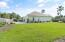Huge corner lot with lots of green space. Double gated fence for your boat