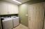 Indoor laundry room off the garage