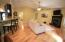Living room is spacious with hickory wood floors and vaulted ceilings!