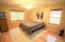 Large master bedroom with hickory wood floors and bright windows!