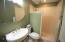 Main bath with double shower heads and medicine cabinet mirror for extra storage!