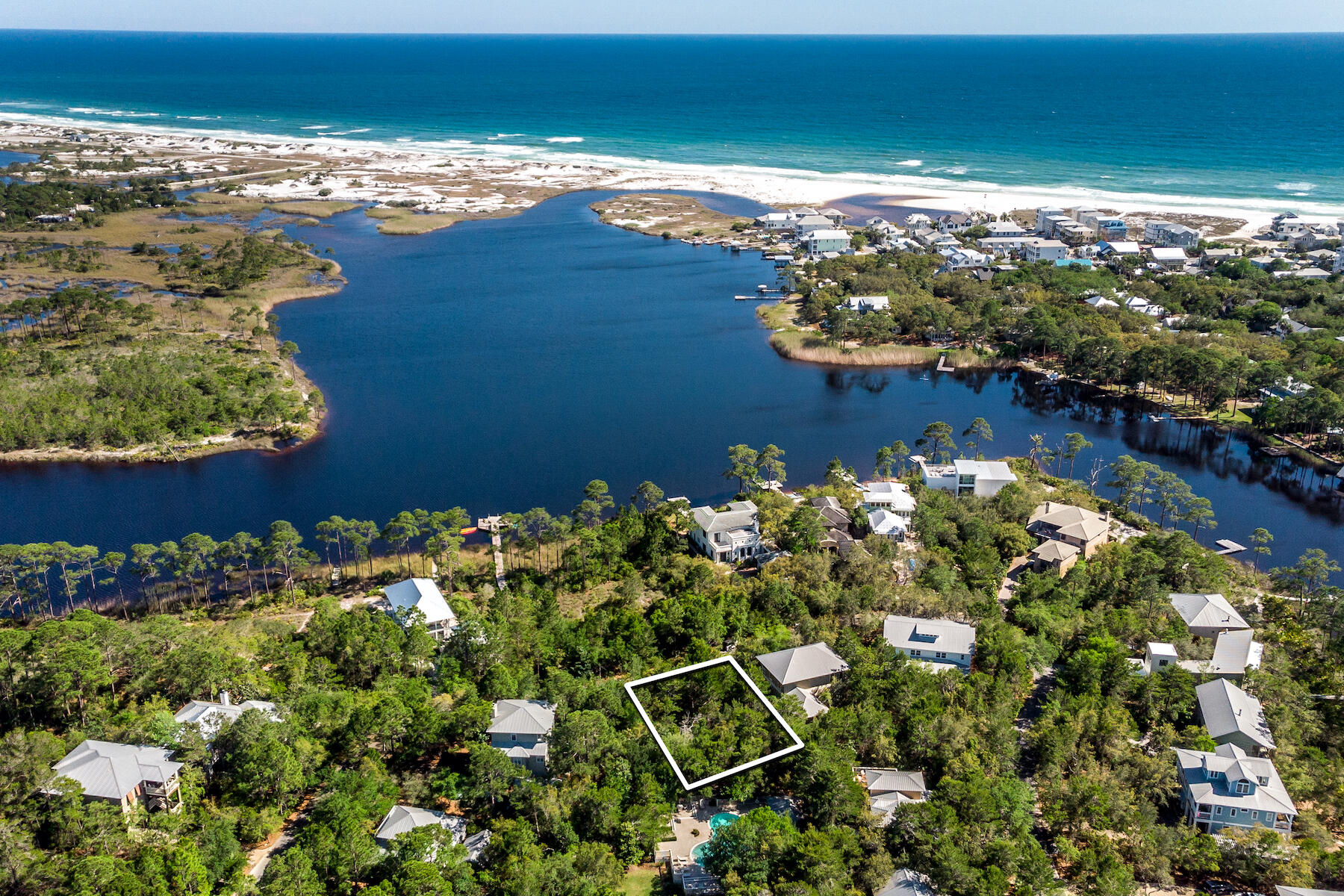 Welcome to Lakeplace in Grayton Beach. This private, gated, short-term rental restricted community is just northeast of historic Grayton Beach and within walking distance of fabulous restaurants and amenities. This is currently the only vacant lot available in the greater Grayton Beach area. This incredible homesite is just one row off of Western Lake and directly across from the community dock. Lake views are achievable at 20' with gulf views at 30'. The neighborhood consists of 50 parcels nestled amongst well developed trees and foliage.Sellers have preliminary plans with approved neighborhood architect, Dan Martin, for a 3-story 3,150 square foot home that would capture views of both the gulf and Western Lake.