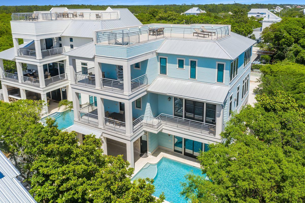 This unparalleled coastal retreat in Seagrove Beach features unimpeded views of the Gulf of Mexico from its position two tiers off the sugar-sand beaches of the Emerald Coast. Completed in 2017, 35 Camellia Street features seven bedrooms and eight full baths spread over more than 5,000 square feet of living space. The gulf views from multiple floors of this home are a hallmark, but just the beginning. Inside, experience an open floor plan bolstered by 12-ft. ceilings, French oak flooring and Italian porcelain tile. The first floor is anchored by an entertaining space that includes a spacious game room and common area as well as a bunk room and king suite. Easy access to the outdoor oasis can be enjoyed here, including a pool deck, Watermark-designed pool, wet bar and custom outdoor kitchen , all flanked by a privacy wall. The second-floor kitchen boasts Wolf and Sub-Zero appliances, custom cabinetry and a handmade Francois & Co. range hood. This floor includes a master suite and bunk room or office space. The third floor's gulf-view master suite is one of four suites on this level and includes ensuite bath with Calcutta marble flooring, soaking tub, walk-in shower and dual vanities. The pièce de résistance, a 724-sq.-ft. rooftop deck, is accessible via a spiral staircase. With a private elevator and oversized two-car garage, 35 Camellia Street offers every convenience in a location that's only minutes away from the shops and restaurants of WaterColor and Seaside, Florida.