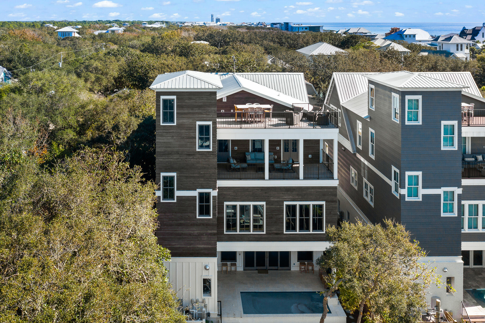 Primely located in the heart of Seagrove Beach, this finely appointed newly-built 30A retreat exempl