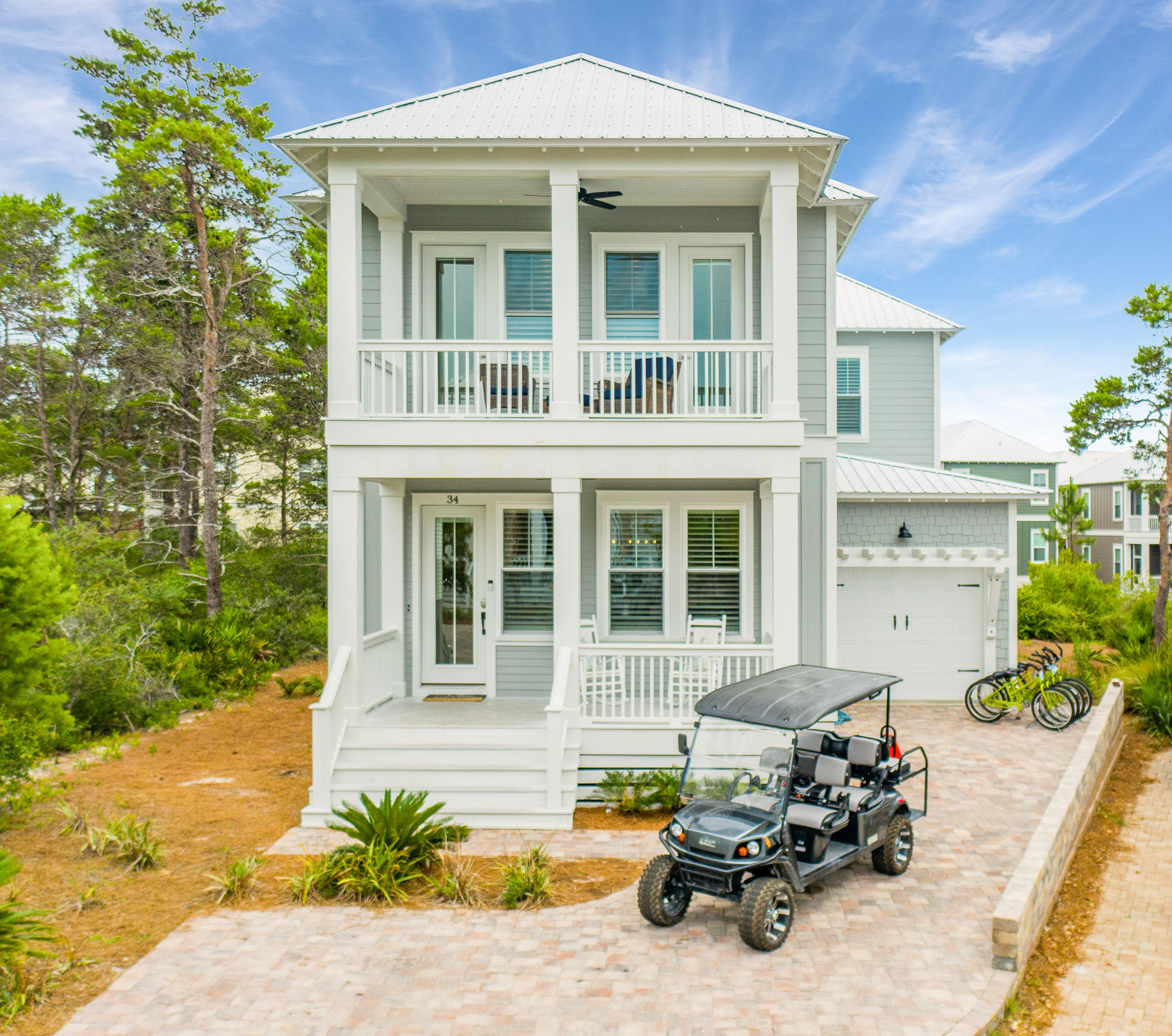 ''Two Rocking Chairs on A Porch'' is in Highlands Parks on a premium lot with 40' pond frontage; currently on Go Southern's rental. Built by Custom Coastal Home Building and positioned for a rental investment.Spaciously designed with four bedrooms and  four and a half baths; modern open interior behind a traditional two-story facade. Three porches provide quiet areas for kicking back and enjoying the breeze whispering through the surrounding trees. Featuring high-end finishes including: shiplap, raised ceilings with crown moldings, polished hardwood floors, custom barn doors adorn the closets in the two masters, one of which is located on the first floor. Veined marble and a deep stand alone soaker tubs are just some of the noteworthy bathroom feature Designed and furnished by Laura Mckee with Dwell Interior Design. Double pane windows flood each room with natural light while the high-tech air to a heat pump makes this an eco-friendly home to run. A fully equipped open-plan kitchen, GE Cafe Appliances enhance the open kitchen with quartz counters and a sizable living and dining area are perfect for entertaining in style. Climb the half-turn staircase to reach the versatile hall recess on the second floor utilized as a media room. Conveniently located on Scenic Highway 30A, this home is surrounded by Point Washington State Forest for hiking and biking in unspoiled surroundings. If you prefer swimming and sunset strolls beside the beautiful Gulf of Mexico, there are two beach access points less than a mile away. Closer to home, take a dip in the pristine community pool with water features, hot tub and social entertainment area. Shopping, cafe's, and amenities nearby, complete your Florida lifestyle. All furnishings, artwork, and housewares convey. The six passenger golf cart is 2020 EZ GO and is negotiable. Current rental bookings with Go Southern to convey.