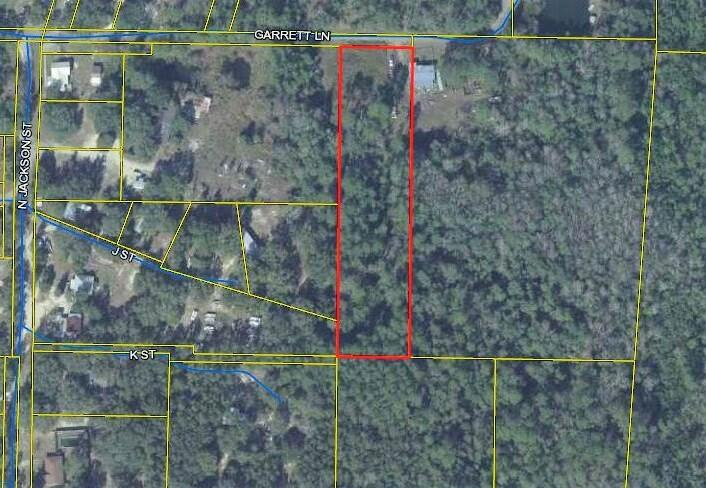 This parcel has lots of potential with approx. 2+ acres in the City of Freeport. Per City of Freeport zoned R-3. 1 Water tap fee paid. There used to be a  mobile home on the property. It appears to be wet on the rear side of the property. No environmental study has been done. Buyer to do diligence. Use caution. Lot is overgrown and could be home to wildlife. All information to be should be verified by Buyer.