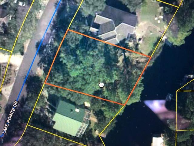 Beautiful coastal dune lake (Eastern Lake)lot in non-rental community waiting for your buyer to buil